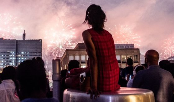 People watch New York City's 41st annual Macy's 4th of July fireworks on July 4, 2017, in New York City.