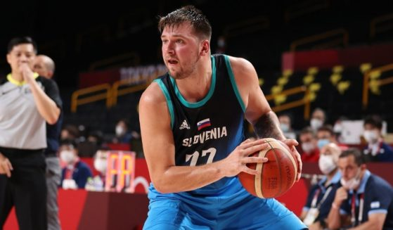 Luka Doncic #77 of Team Slovenia drops back to shoot a three point basket against Argentina during the second half on day three of the Tokyo 2020 Olympic Games at Saitama Super Arena on Monday in Saitama, Japan