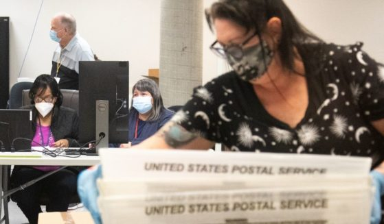 Ballots are counted by Maricopa County Elections Department staff on Oct. 31, 2020, in Phoenix.