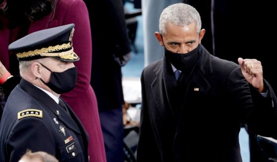 Former president Barack Obama, right, is seen next to Joint Chiefs of Staff Chairman Mark Milley prior during the 59th Presidential Inauguration on Jan. 20, 2021, in Washington, D.C.