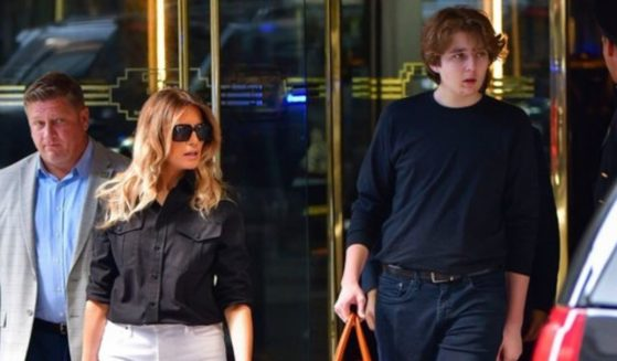 Barron Trump, the 15-year-old son of former President Donald Trump, towers over his mother, former first lady Melania Trump, as they leave the Trump Tower in New York on Wednesday.