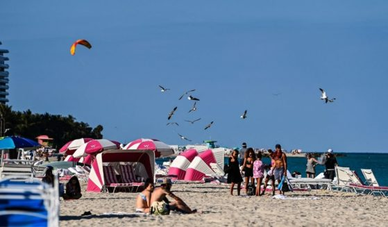 People relax on the beach in Miami Beach, Florida, on March 23.
