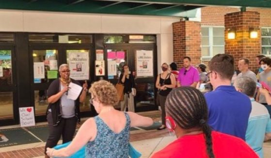 Michelle Leete attacks opponents of CRT at a protest outside the Fairfax County school board meeting in Virginia.