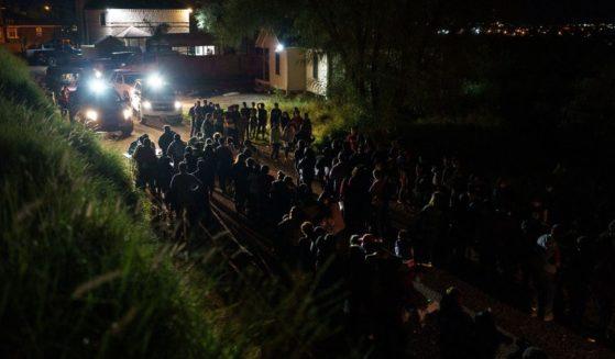 Border Patrol agents process dozens of migrants who crossed the U.S.-Mexico border into Roma, Texas, on July 9.