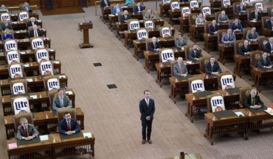 Texas state Rep. Cody Harris, a Republican, posted a meme to Twitter, placing cans of Miller Lite beer in seats typically occupied by state Democrats.