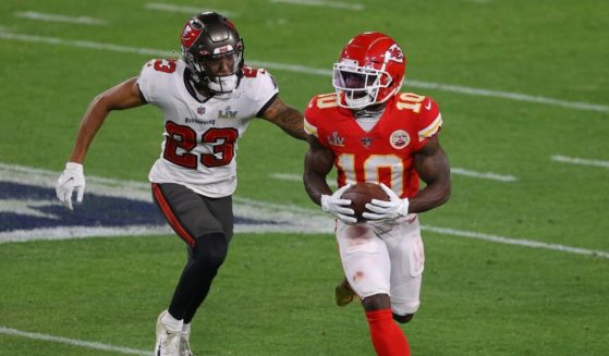 Tyreek Hill, right, of the Kansas City Chiefs rushes ahead of Sean Murphy-Bunting of the Tampa Bay Buccaneers during the third quarter of the game in Super Bowl LV at Raymond James Stadium on Feb. 7, 2021, in Tampa, Florida.