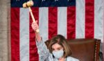 Speaker of the House Nancy Pelosi holds the speaker's gavel in the air on the House floor in the Capitol after becoming Speaker of the 117th Congress on Jan. 3, 2021, in Washington, D.C.