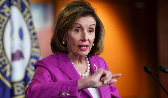 Speaker of the House Nancy Pelosi talks to reporters at the Capitol in Washington on Wednesday.