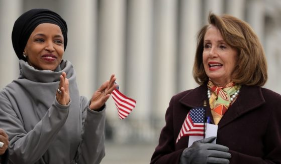 Democratic Rep. Ilhan Omar of Minnesota and Speaker of the House Nancy Pelosi rally with fellow Democrats on the East Steps of the U.S. Capitol on March 8, 2019, in Washington, D.C.