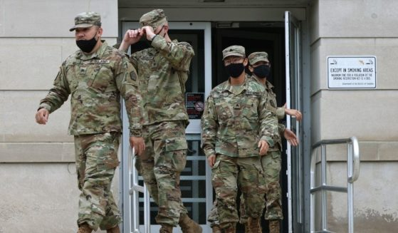 National Guard troops make their way to buses as they leave the Armory after ending their mission of providing security to the U.S. Capitol on May 24 in Washington, D.C.