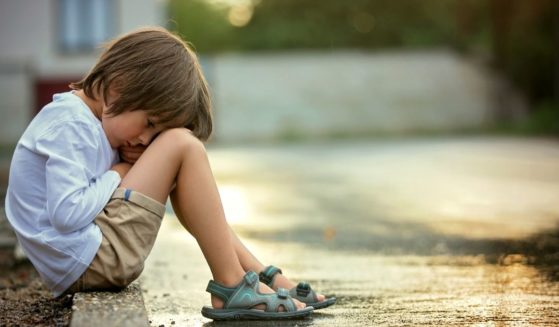 A neglected child is pictured in the stock image above.