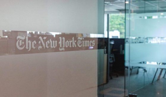 A logo is seen at the entrance of The New York Times offices in Hong Kong on July 15, 2020.