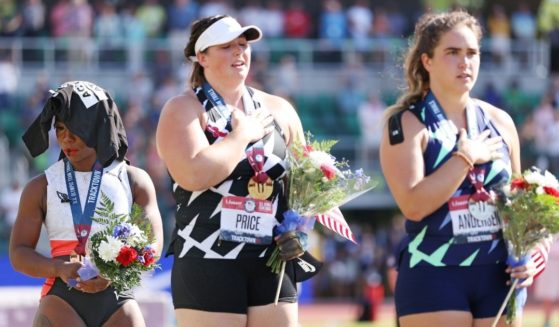 DeAnna Price, center, stands on the first place podium, alongside Gwendolyn Berry (third place), left, and Brooke Andersen (second place), after the Women's Hammer Throw final on day nine of the 2020 U.S. Olympic Track & Field Team Trials at Hayward Field on Saturday in Eugene, Oregon.