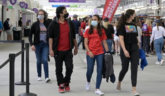 Fans wear face masks as they arrive for a SheBelieves Cup women's soccer match between the United States and Brazil at Exploria Stadium in Orlando, Florida, on Feb. 21.