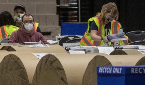 Election workers count ballots at the Philadelphia Convention Center on Nov. 6, 2020 in Philadelphia, Pennsylvania.