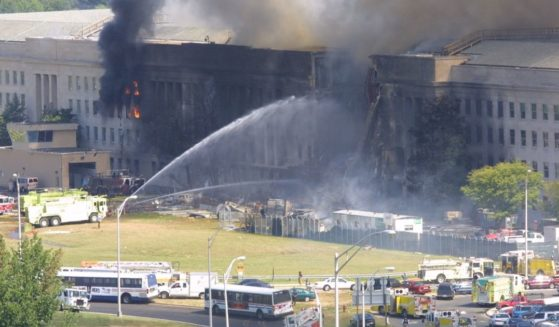 Smoke comes out from the west wing of the Pentagon building on Sept. 11, 2001, in Arlington, Virginia, after a plane crashed into the building and set off a huge explosion.
