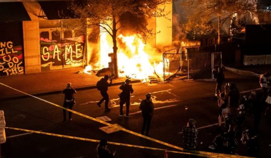 Rioters set fire to a building on April 17, 2021, in Portland, Oregon.