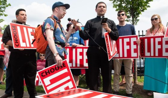 Pro-life demonstrators hold a protest outside the Planned Parenthood Reproductive Health Services Center in St. Louis on May 31, 2019.