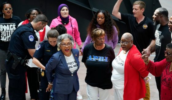 Ohio Democratic Rep. Joyce Beatty, chairwoman of the Congressional Black Caucus, is taken into custody by U.S. Capitol Police officers along with other activists after their incursion of the Hart Senate Office Building on Capitol Hill in Washington on Thursday.