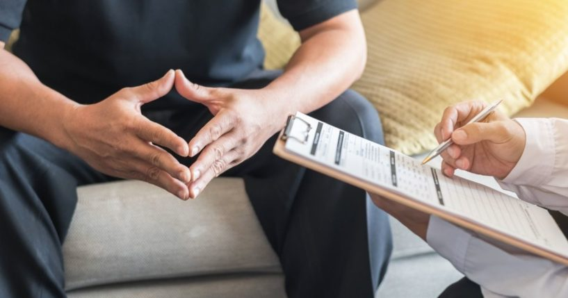 A psychiatrist is pictured meeting with a patient in the stock image above.