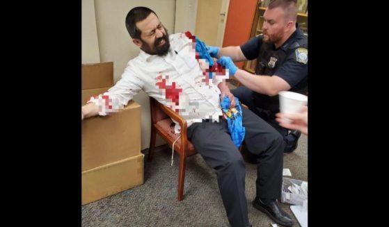 Rabbi Shlomo Noginski, left, was reportedly stabbed eight times in the Brighton Common park near Shaloh House in Brighton, Massachusetts.