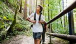 """This stock photo portrays a boy enjoying an outdoors hiking trail with his family. This week, Outside magazine published a piece concerning the """"nature gap"""" that is perpetuating systemic racism."""