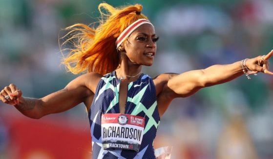 Sha'Carri Richardson runs in the women's 100-meter semifinal at the U.S. Olympic track and field trials at Hayward Field in Eugene, Oregon, on June 19.