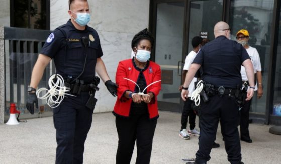 Democratic Rep. Sheila Jackson Lee of Texas is arrested by a member of U.S. Capitol Police during a protest outside Hart Senate Office Building on Capitol Hill on Thursday in Washington, D.C.