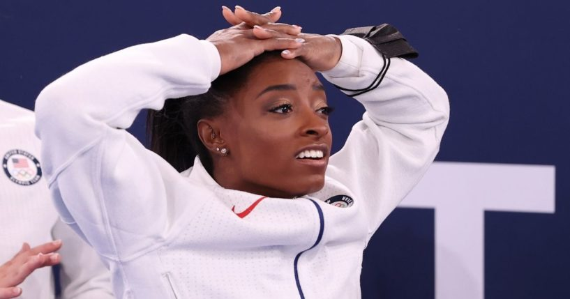 Simone Biles reacts during the women's gymnastics team final of the Tokyo Olympic Games at the Ariake Gymnastics Centre on Tuesday.