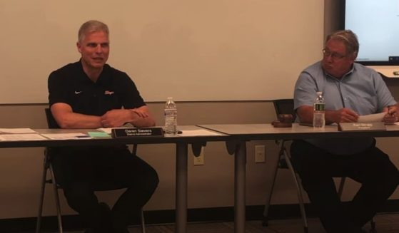 Superintendent Daren Sievers, left, of the Slinger School District in Wisconsin, speaks during a meeting with parents.