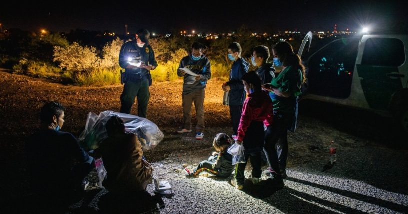 Migrants are accounted for and processed by Border Patrol officers after crossing the Rio Grande into the United States on July 1, 2021, in Roma, Texas.