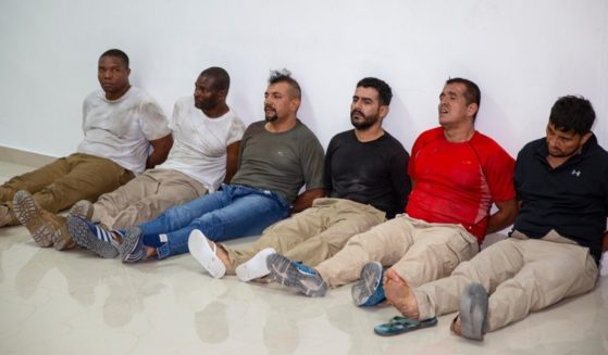 Suspects in the assassination of Haiti's President Jovenel Moise, among them Haitian-American citizens James Solages, left, and Joseph Vincent, second left, are shown to the media at the General Direction of the police in Port-au-Prince, Haiti, on Thursday. Moise was assassinated in an attack on his private residence early Wednesday.