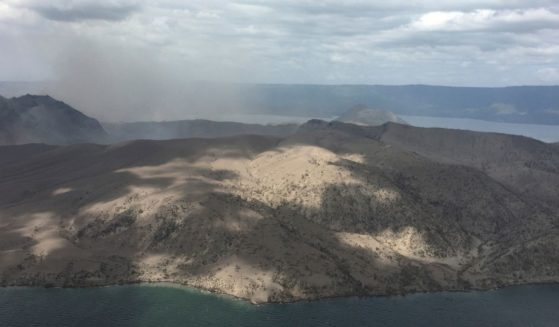 In this Jan. 21, 2020, handout photo provided by the Office of Civil Defense, Taal volcano emits small amounts of ash in Batangas province, southern Philippines.