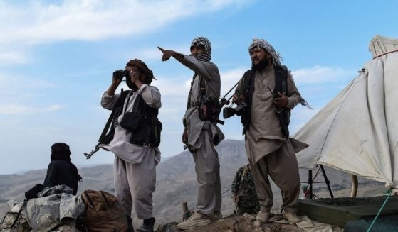 Afghan militia fighters keep watch against Taliban insurgents at an outpost in Balkh province, Afghanistan, on July 15, 2021.