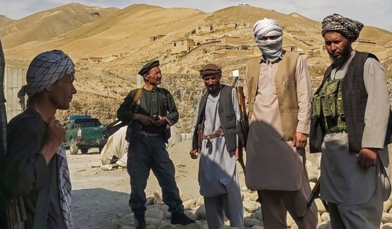 Afghan militia forces stand guard at an outpost in the northern Takhar province on Tuesday.