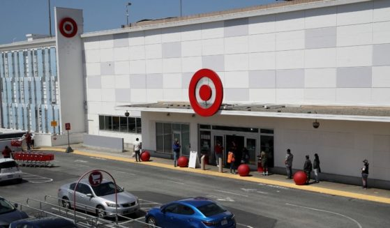In this aerial view from a drone, people wait in line to enter a Target store on April 13, 2020 in San Francisco, California.