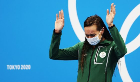 Tatjana Schoenmaker of South Africa is seen on the podium after winning gold and breaking the world record in the women's 200-meter breaststroke at the Tokyo Olympic Games on Friday in Tokyo.