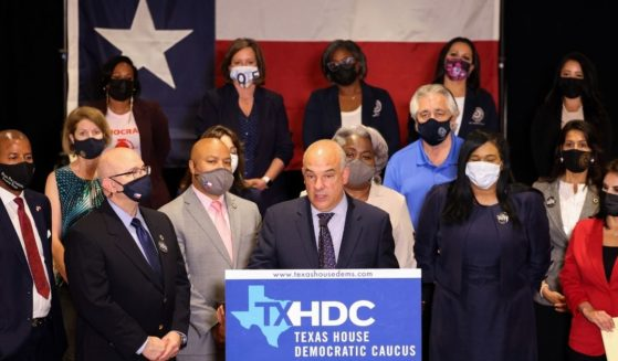 Texas State House Democratic Caucus Chair Rep. Chris Turner, joined by fellow Democratic Texas state representatives, speaks at a news conference on Tuesday in Washington, D.C.