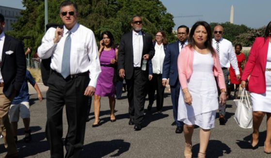 Texas Democratic legislators, who fled their state to block election integrity legislation, arrive for a news conference outside the U.S. Capitol in Washington on Tuesday.