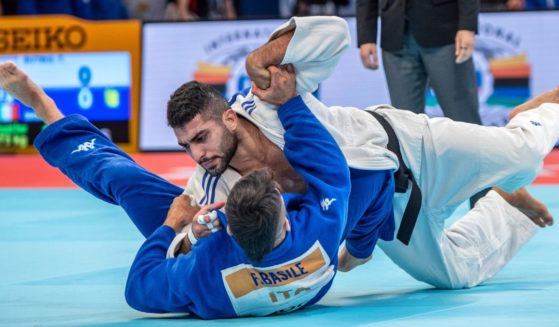Tohar Butbul of Israel throws Rio Olympic champion Fabio Basile of Italy without a score.