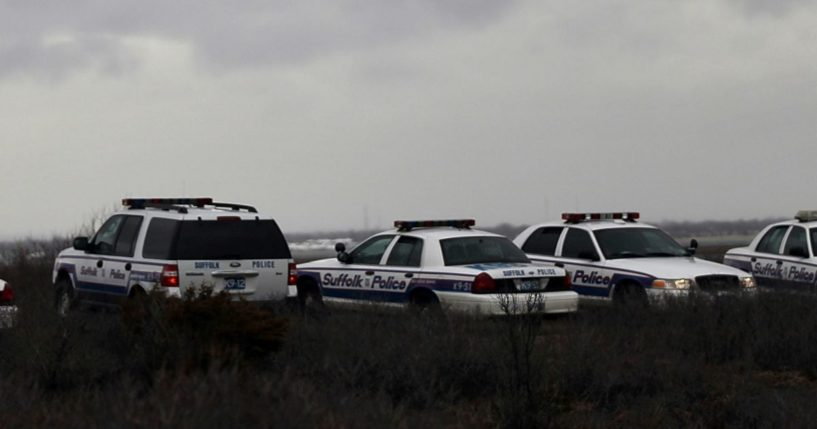 Suffolk County Police cars involved in a search effort are parked on the side of the road along a stretch of beach highway on April 5, 2011, in Babylon, New York.