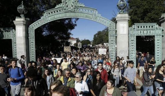 A crowd walks under the Sather Gate at the University of California Berkeley in this Nov. 24, 2014 photo.