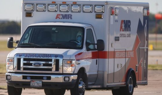 An ambulance is seen driving on the tarmac at the Love Health Field Airport in Dallas on Oct. 15, 2014.