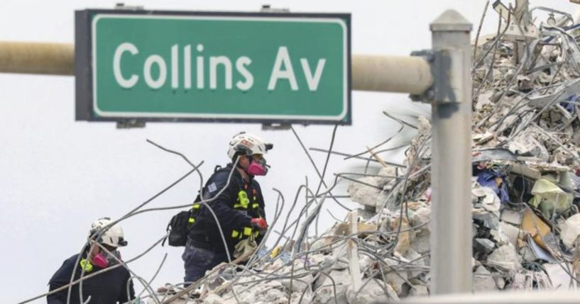 A rescue team is seen walking through the debris at the Champlain Towers South Condo in Surfside, Florida, on July 7.
