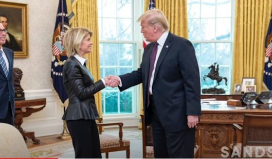 Carla Sands is greeted by President Donald Trump during Trump's tenure in the White House. Sands was the U.S. ambassador to Denmark.
