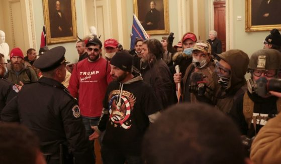 Protesters and Capitol Police square off inside the Capitol during the Jan. 6 incursion that left protester Ashli Babbitt shot dead. Authorities have