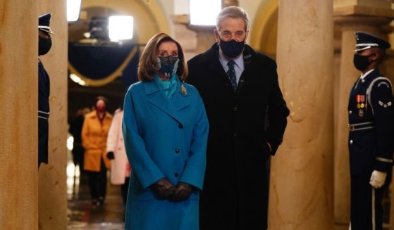 Speaker of the House Nancy Pelosi and her husband, Paul, arrive at the U.S. Capitol for Joe Biden's inauguration ceremony as president on Jan. 20, 2021.