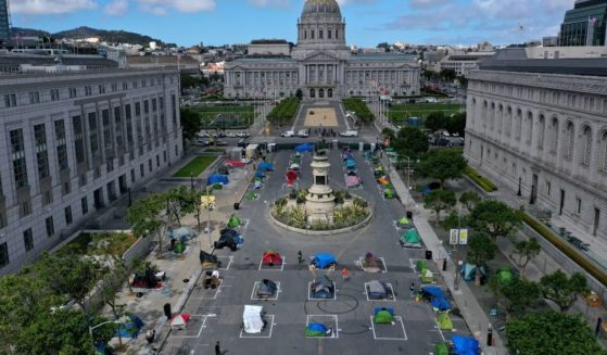 An aerial view shows a tent encampment for the homeless in San Francisco on May 18, 2020. The camp provides a sleeping area in a fenced-off space near City Hall with marked spots for tents that practice social distancing.