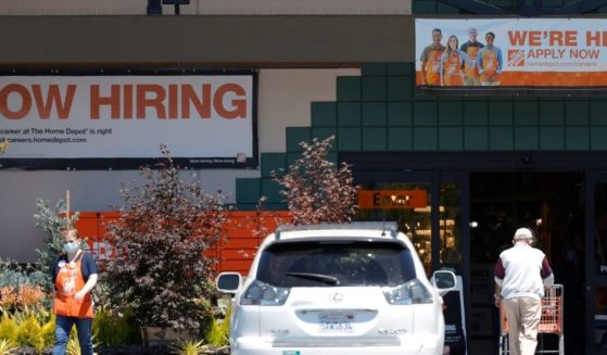 """""""Now Hiring"""" signs posted in front of a Home Depot store last week in San Rafael, California."""