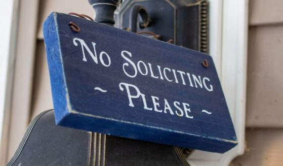 """A """"no soliciting, please"""" sign."""